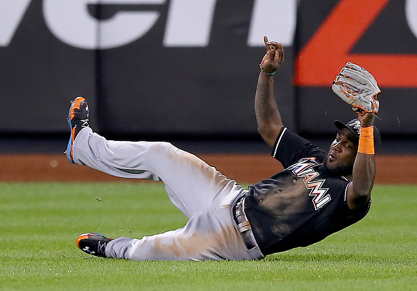 NEW YORK, NY - SEPTEMBER 15:  Marcell Ozuna #13 of the Miami Marlins makes the catch for the out in the ninth inning against the New York Mets on September 15, 2015 at Citi Field in the Flushing neighborhood of the Queens borough of New York City.  (Photo by Elsa/Getty Images)