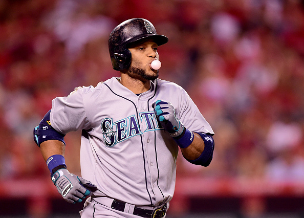 ANAHEIM, CA - SEPTEMBER 25: Robinson Cano #22 of the Seattle Mariners reacts as he is thrown out during the third inning against the Los Angeles Angels at Angel Stadium of Anaheim on September 25, 2015 in Anaheim, California. (Photo by Harry How/Getty Images)