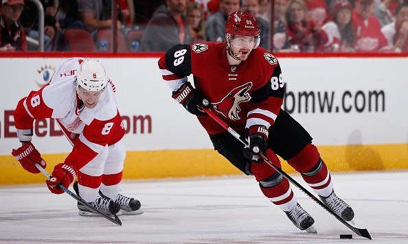 GLENDALE, AZ - JANUARY 14:  Mikkel Boedker #89 of the Arizona Coyotes skates with the puck ahead of Justin Abdelkader #8 of the Detroit Red Wings during the NHL game at Gila River Arena on January 14, 2016 in Glendale, Arizona. The Red Wings defeated the Coyotes 3-2 in overtime. (Photo by Christian Petersen/Getty Images)