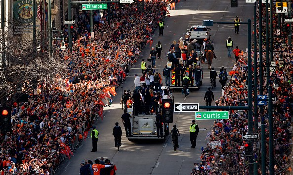DENVER, CO - FEBRUARY 9:  Denver Broncos players ride fire trucks as fans line the streets during a victory parade to celebrate their Super Bowl championship on February 9, 2016 in Denver, Colorado. The Broncos defeated the Panthers 24-10 in Super Bowl 50. (Photo by Justin Edmonds/Getty Images) *** Local Caption ***