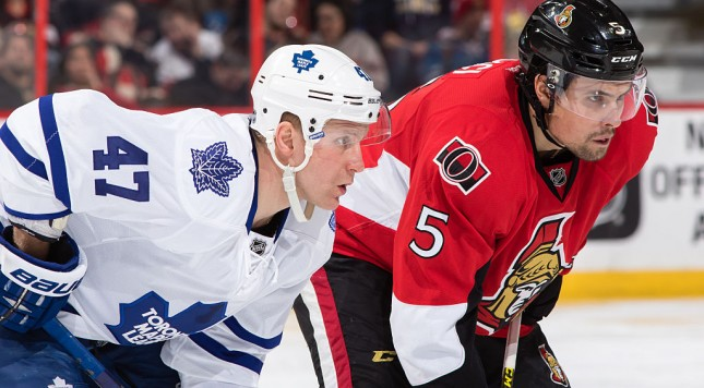 OTTAWA, ON - FEBRUARY 6: Cody Ceci #5 of the Ottawa Senators prepares for a faceoff against Leo Komarov #47 of the Toronto Maple Leafs during an NHL game at Canadian Tire Centre on February 6, 2016 in Ottawa, Ontario, Canada.  (Photo by Jana Chytilova/Freestyle Photography/Getty Images)