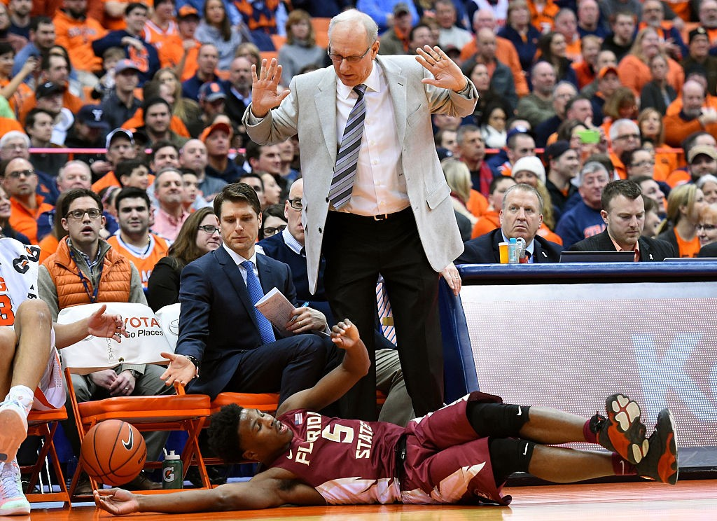 SYRACUSE, NY - FEBRUARY 11:  Malik Beasley #5 of the Florida State Seminoles dives for a loose ball at the feet of head coach Jim Boeheim of the Syracuse Orange during the second half at the Carrier Dome on February 11, 2016 in Syracuse, New York.  Syracuse won 85-72.  (Photo by Rich Barnes/Getty Images)
