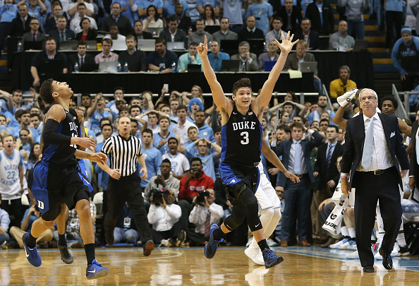 CHAPEL HILL, NC - FEBRUARY 17:  Derryck Thornton #12 watches as teammate Grayson Allen #3 of the Duke Blue Devils celebrates after defeating the North Carolina Tar Heels 74-73 as head coach Roy Williams watches on during their game at Dean Smith Center on February 17, 2016 in Chapel Hill, North Carolina.  (Photo by Streeter Lecka/Getty Images)