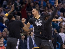 OKLAHOMA CITY, OK - FEBRUARY 27: After scoring the winning three-point shot Stephen Curry #30 of the Golden State Warriors celebrates during the overtime period of a NBA game against the Oklahoma City Thunder at the Chesapeake Energy Arena on February 27, 2016 in Oklahoma City, Oklahoma. The Warriors won 121-118 in overtime. NOTE TO USER: User expressly acknowledges and agrees that, by downloading and or using this photograph, User is consenting to the terms and conditions of the Getty Images License Agreement. (Photo by J Pat Carter/Getty Images)