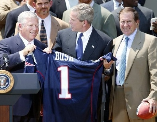 New England Patriots owner Bob Kraft (left), U.S. President George W. Bush (center), and Patriots head coach Bill Belichick during a photo opportunity with the Super Bowl champions in the Rose Garden on May 10, 2004. Photo: whitehouse.gov