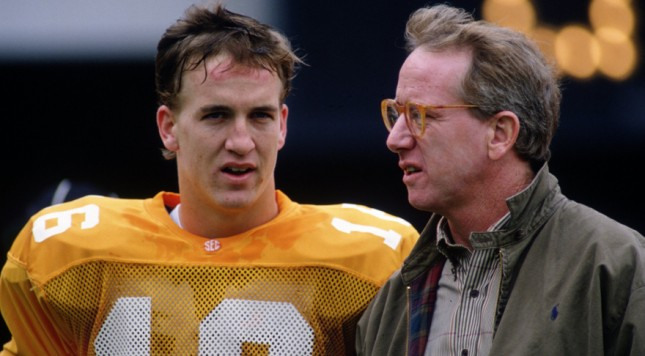 23 SEP 1995:  TENNESSEE QUARTERBACK PEYTON MANNING WITH HIS FATHER ARCHIE MANNING DURING THE VOLUNTEERS 52-14 VICTORY OVER THE MISSISSIPPI STATE BULLDOGS AT NEYLAND STADIUM IN KNOXVILLE, TENNESSEE.  ARCHIE PLAYED QUARTERBACK FOR THE UNIVERSITY OF MISSISSI