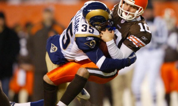 CLEVELAND - DECEMBER 8:  Kelly Holcomb #10 of the Cleveland Browns is sacked by Aeneas Williams #35 of the St. Louis Rams during the game December 8, 2003 at Cleveland Browns Stadium in Cleveland, Ohio.  (Photo by Andy Lyons/Getty Images)