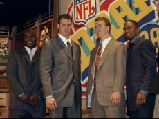 18 Apr 1998:  Running back Curtis Enis, defensive back Charles Woodson and quarterbacks Ryan Leaf and Peyton Manning stand together during the NFL draft at Madison Square Garden in New York City, New York. Mandatory Credit: Jamie Squire  /Allsport