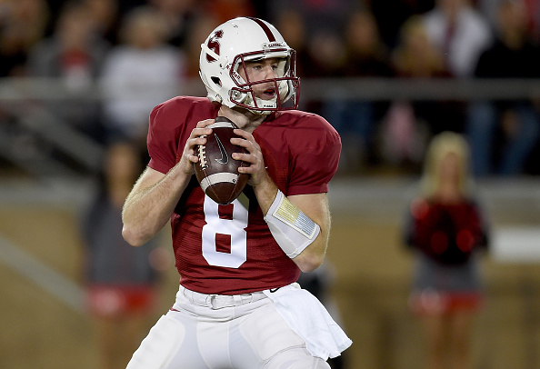 PALO ALTO, CA - NOVEMBER 15:  Kevin Hogan #8 of the Stanford Cardinal drops back to pass against the Utah Utes in the third quarter at Stanford Stadium on November 15, 2014 in Palo Alto, California.  (Photo by Thearon W. Henderson/Getty Images)