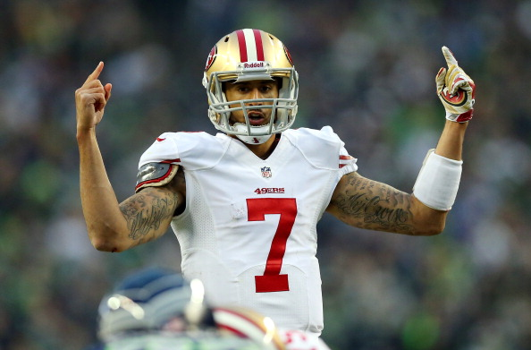 SEATTLE, WA - JANUARY 19:  Quarterback Colin Kaepernick #7 of the San Francisco 49ers calls a play against the Seattle Seahawks during the 2014 NFC Championship at CenturyLink Field on January 19, 2014 in Seattle, Washington.  (Photo by Ronald Martinez/Getty Images)