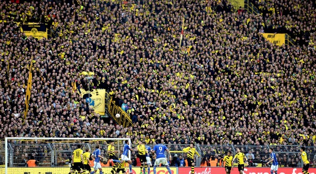 DORTMUND, GERMANY - FEBRUARY 28:  The south booth 'Die Gelbe Wand' of Dortmund is seen during the Bundesliga match between Borussia Dortmund and FC Schalke 04 at Signal Iduna Park on February 28, 2015 in Dortmund, Germany.  (Photo by Sascha Steinbach/Getty Images for MAN)