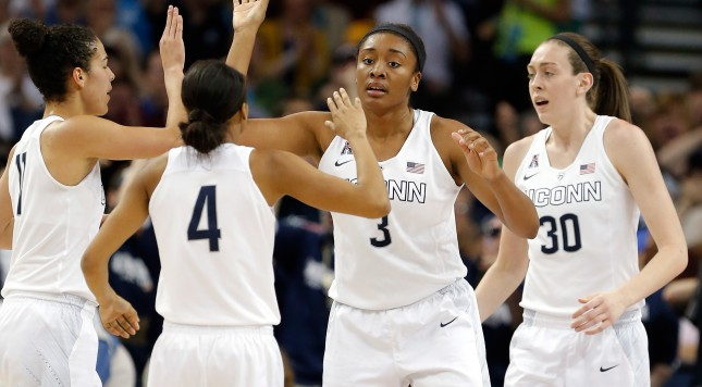 TAMPA, FL - APRIL 07:  Morgan Tuck #3 of the Connecticut Huskies celebrates with her teammates against the Notre Dame Fighting Irish in the second half during the NCAA Women's Final Four National Championship at Amalie Arena on April 7, 2015 in Tampa, Florida.  (Photo by Mike Carlson/Getty Images)