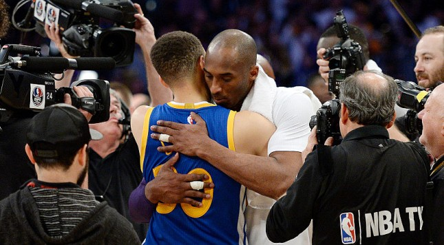 LOS ANGELES, CA - MARCH 6: Kobe Bryant #24 of the Los Angeles Lakers hugs Stephen Curry #30 of the Golden State Warriors at the end of the basketball game at Staples Center March 6, 2016, in Los Angeles, California. NOTE TO USER: User expressly acknowledges and agrees that, by downloading and or using the photograph, User is consenting to the terms and conditions of the Getty Images License Agreement. (Photo by Kevork Djansezian/Getty Images)