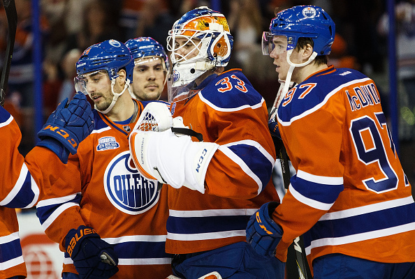 EDMONTON, AB - MARCH 18:  Jordan Eberle #14, Adam Clendening #27, goaltender Cam Talbot #33 and Connor McDavid #97 of the Edmonton Oilers celebrate their victory against the Vancouver Canucks on March 18, 2016 at Rexall Place in Edmonton, Alberta, Canada. (Photo by Codie McLachlan/Getty Images)