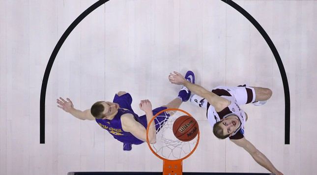 OKLAHOMA CITY, OK - MARCH 20:  Alex Caruso #21 of the Texas A&M Aggies takes a shot against Paul Jesperson #4 of the Northern Iowa Panthers in the second round of the 2016 NCAA Men's Basketball Tournament at Chesapeake Energy Arena on March 20, 2016 in Oklahoma City, Oklahoma.  (Photo by Ronald Martinez/Getty Images)