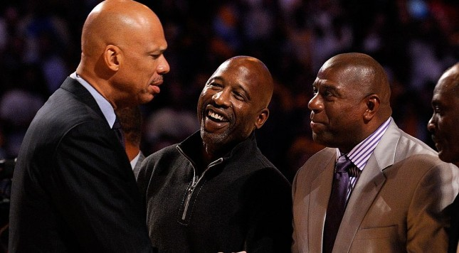 LOS ANGELES, CA - OCTOBER 27:  (L-R) Assistant coach Kareem Abdul-Jabbar (L) of the Los Angeles Lakers is congratulated by former Laker champions James Worthy and Magic Johnson after receiving his 2009 NBA Championship ring before the season opening game against the Los Angeles Clippers at Staples Center on October 27, 2009 in Los Angeles, California.  NOTE TO USER: User expressly acknowledges and agrees that, by downloading and or using this photograph, User is consenting to the terms and conditions of the Getty Images License Agreement. Mandatory Copyright Notice: Copyright 2009 NBAE  (Photo by Kevork Djansezian/Getty Images)