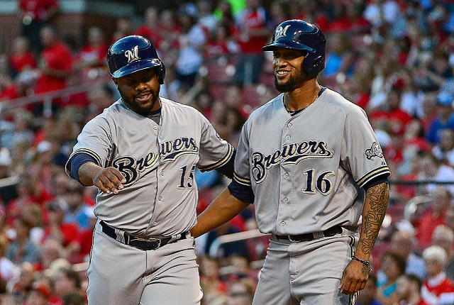 ST. LOUIS, MO - SEPTEMBER 24: Jason Rogers #15 and Domingo Santana #16 of the Milwaukee Brewers celebrate after scoring against the St. Louis Cardinals during the first inning at Busch Stadium on September 24, 2015 in St. Louis, Missouri.  (Photo by Jeff Curry/Getty Images)