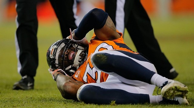 DENVER, CO - DECEMBER 28:  Strong safety David Bruton #30 of the Denver Broncos lies on the ground in pain after a play that would force him out of the game with a reported concussion during a game against the Oakland Raiders at Sports Authority Field at Mile High on December 28, 2014 in Denver, Colorado.  (Photo by Doug Pensinger/Getty Images)
