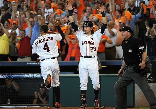 HOUSTON, TX - OCTOBER 12: George Springer #4 of the Houston Astros celebrates with Colby Rasmus #28 after scoring the go ahead run on an RBI double in the fifth inning against the Kansas City Royals during game four of the American League Divison Series at Minute Maid Park on October 12, 2015 in Houston, Texas. (Photo by Eric Christian Smith/Getty Images)