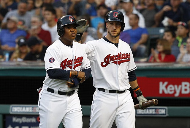 CLEVELAND, OH - AUGUST 13:  Jose Ramirez #11 of the Cleveland Indians celebrates with Yan Gomes #10 after scoring against the New York Yankees during the third inning of their game on August 13, 2015 at Progressive Field in Cleveland, Ohio.  The Yankees defeated the Indians 8-6.   (Photo by David Maxwell/Getty Images)