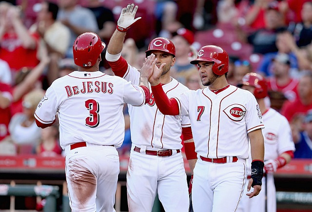 CINCINNATI, OH - JULY 22: Ivan de Jesus #3 of the Cincinnati Reds is congratulated by Eugenio Suarez #7 after scoring in the second inning against the Chicago Cubs during the second game of a doubleheader at Great American Ball Park on July 22, 2015 in Cincinnati, Ohio. (Photo by Andy Lyons/Getty Images)