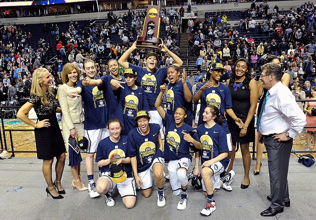 NASHVILLE, TN - APRIL 08:  The Connecticut Huskies celebrate with their trophy after a 79-58 victory over the Notre Dame Fighting Irish in the NCAA Women's Basketball Tournament Championship game at Bridgestone Arena on April 8, 2014 in Nashville, Tennessee.  (Photo by Frederick Breedon/Getty Images)