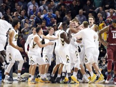 Mar 18, 2016; Brooklyn, NY, USA; Iowa Hawkeyes center Adam Woodbury (34) is congratulated by teammates after scoring the game-winning basket in overtime against the Temple Owls in the first round of the 2016 NCAA Tournament at Barclays Center. Mandatory Credit: Robert Deutsch-USA TODAY Sports ORG XMIT: USATSI-264942 ORIG FILE ID:  20160318_jel_usa_110.jpg