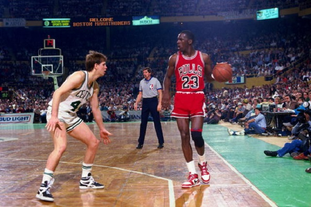 BOSTON - APRIL 17:  Michael Jordan #23 of the Chicago Bulls moves the ball against Danny Ainge #44 of the Boston Celtics in Game One of the Eastern Conference Quarterfinals during the 1986 NBA Playoffs on April 17, 1986 at the Boston Garden in Boston, Massachusetts. The Boston Celtics defeated the Chicago Bulls 123-104 and won the series 3-0. (Photo by Dick Raphael/NBAE via Getty Images)