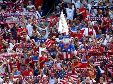 HARRISON, NJ - JUNE 01:  United States fans hold up their scarves during the national anthem before the match against Turkey during an international friendly match at Red Bull Arena on June 1, 2014 in Harrison, New Jersey.  (Photo by Elsa/Getty Images)