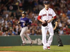 BOSTON, MA - MAY 26:  Clay Buchholz #11 of the Boston Red Sox reacts after Dustin Garneau #13 of the Colorado Rockies hit a two run homer during the fifth inning at Fenway Park on May 26, 2016 in Boston, Massachusetts.  (Photo by Maddie Meyer/Getty Images)