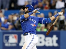 TORONTO, ON - OCTOBER 14:  Jose Bautista #19 of the Toronto Blue Jays hits a three-run home run in the seventh inning against the Texas Rangers in game five of the American League Division Series at Rogers Centre on October 14, 2015 in Toronto, Canada.  (Photo by Vaughn Ridley/Getty Images)