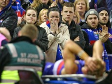 MELBOURNE, AUSTRALIA - JULY 23:  Bulldogs fans react as Mitch Wallis of the Bulldogs leaves the field injured during the round 18 AFL match between the Western Bulldogs and the St Kilda Saints at Etihad Stadium on July 23, 2016 in Melbourne, Australia.  (Photo by Scott Barbour/Getty Images)