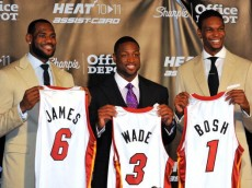 MIAMI - JULY 09:  LeBron James #6, Dwyane Wade #3 and Chris Bosh #1 of the Miami Heat show off their new game jerseys before a press conference after a welcome party at American Airlines Arena on July 9, 2010 in Miami, Florida.  (Photo by Doug Benc/Getty Images)