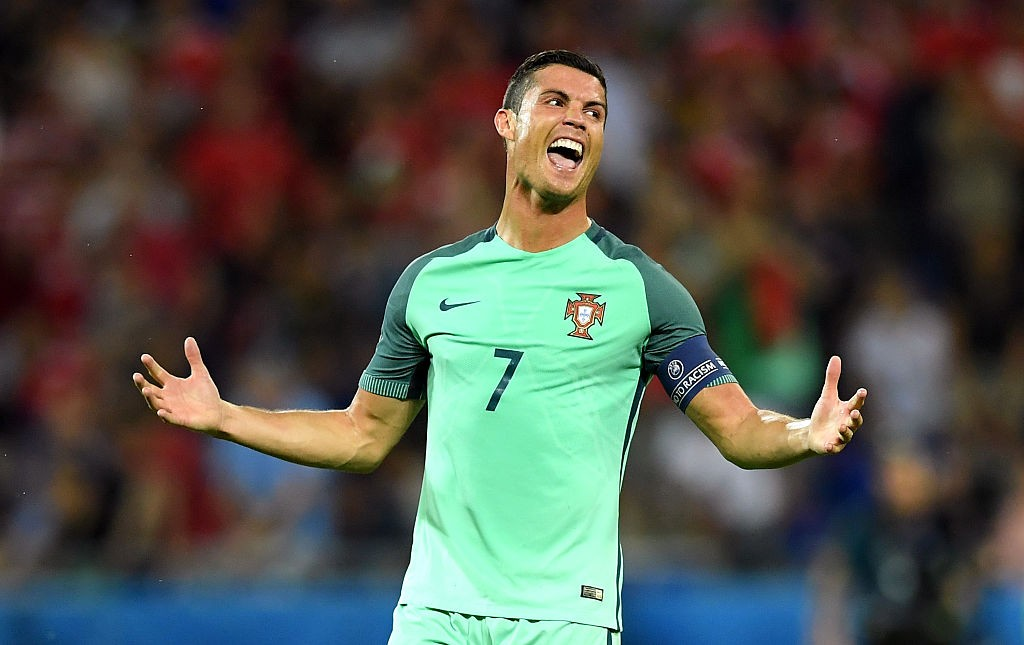 LYON, FRANCE - JULY 06:  Cristiano Ronaldo of Portugal celebrates at the final whistle during the UEFA EURO 2016 semi final match between Portugal and Wales at Stade des Lumieres on July 6, 2016 in Lyon, France.  (Photo by Matthias Hangst/Getty Images)