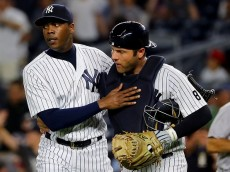 NEW YORK, NY - JULY 17: Aroldis Chapman #54 and Austin Romine #27 of the New York Yankees celebrate the 3-1 win over the Boston Red Sox at Yankee Stadium on July 17, 2016 in the Bronx borough of New York City. (Photo by Elsa/Getty Images)