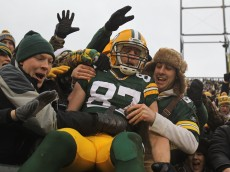 GREEN BAY, WI - JANUARY 01: Jordy Nelson #87 of the Green Bay Packers leaps into the stands after scoring a touchdown against the Detroit Lions at Lambeau Field on January 1, 2012 in Green Bay, Wisconsin. (Photo by Jonathan Daniel/Getty Images)