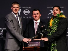 NEW YORK, NY - DECEMBER 08:  (L-R) Heisman finalists quarterback Collin Klein of the Kansas State Wildcats, quarterback Johnny Manziel of the Texas A&M University Aggies and linebacker Manti Te'o of the University of Notre Dame Fighting Irish pose with the Heisman Memorial Trophy Award after a press conference prior to the 78th  Heisman Trophy Presentation at the Marriott Marquis on December 8, 2012 in New York City.  (Photo by Mike Stobe/Getty Images)