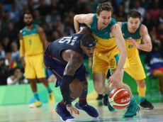RIO DE JANEIRO, BRAZIL - AUGUST 10:  Carmelo Anthony #15 of United States goes for the loose ball against Cameron Bairstow #10 and Matthew Dellavedova #8 of Australia during the Men's Preliminary Round Group A between Australia and the United States on Day 5 of the Rio 2016 Olympic Games at Carioca Arena 1 on August 10, 2016 in Rio de Janeiro, Brazil.  (Photo by Phil Walter/Getty Images)