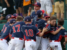 SOUTH WILLIAMSPORT, PA - AUGUST 27:  Members of the Mid-Atlantic Team from New York celebrate after defeating the Asia-Pacific team from South Korea 2-1 to win the Little League World Series Championship Game at Lamade Stadium on August 27, 2016 in South Williamsport, Pennsylvania.  (Photo by Rob Carr/Getty Images)