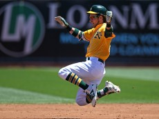 OAKLAND, CA - JULY 20:  Josh Reddick #22 of the Oakland Athletics slides safely into second base against the Houston Astros during the game at the Oakland Coliseum on Wednesday, July 20, 2016 in Oakland, California. (Photo by Brad Mangin/MLB Photos via Getty Images)