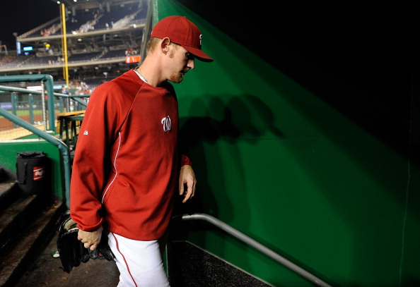 WASHINGTON, DC - AUGUST 21: Stephen Strasburg #37 of the Washington Nationals walks off the field after a game against the Atlanta Braves at Nationals Park on August 21, 2012 in Washington, DC. (Photo by Patrick McDermott/Getty Images)