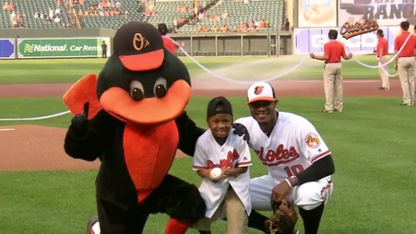 Child who had double hand transplant throws out MLB first pitch