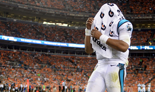 DENVER, CO - SEPTEMBER 08:  Quarterback Cam Newton #1 of the Carolina Panthers wears a towel over his head late in the second half while taking on the Denver Broncos at Sports Authority Field at Mile High on September 8, 2016 in Denver, Colorado.  (Photo by Dustin Bradford/Getty Images)