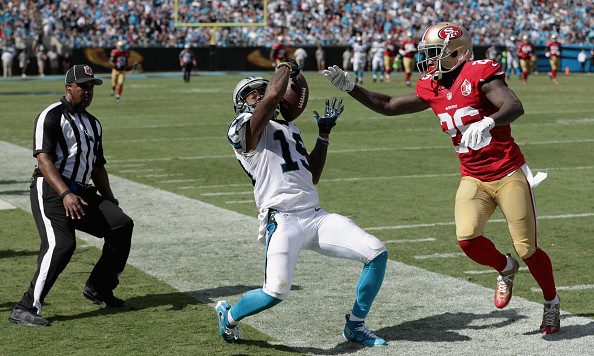 CHARLOTTE, NC - SEPTEMBER 18:   Ted Ginn #19 of the Carolina Panthers tries to maintain possession against Tramaine Brock #26 of the San Francisco 49ers as they go out of bounds in the 3rd quarter during their game at Bank of America Stadium on September 18, 2016 in Charlotte, North Carolina.  (Photo by Streeter Lecka/Getty Images)