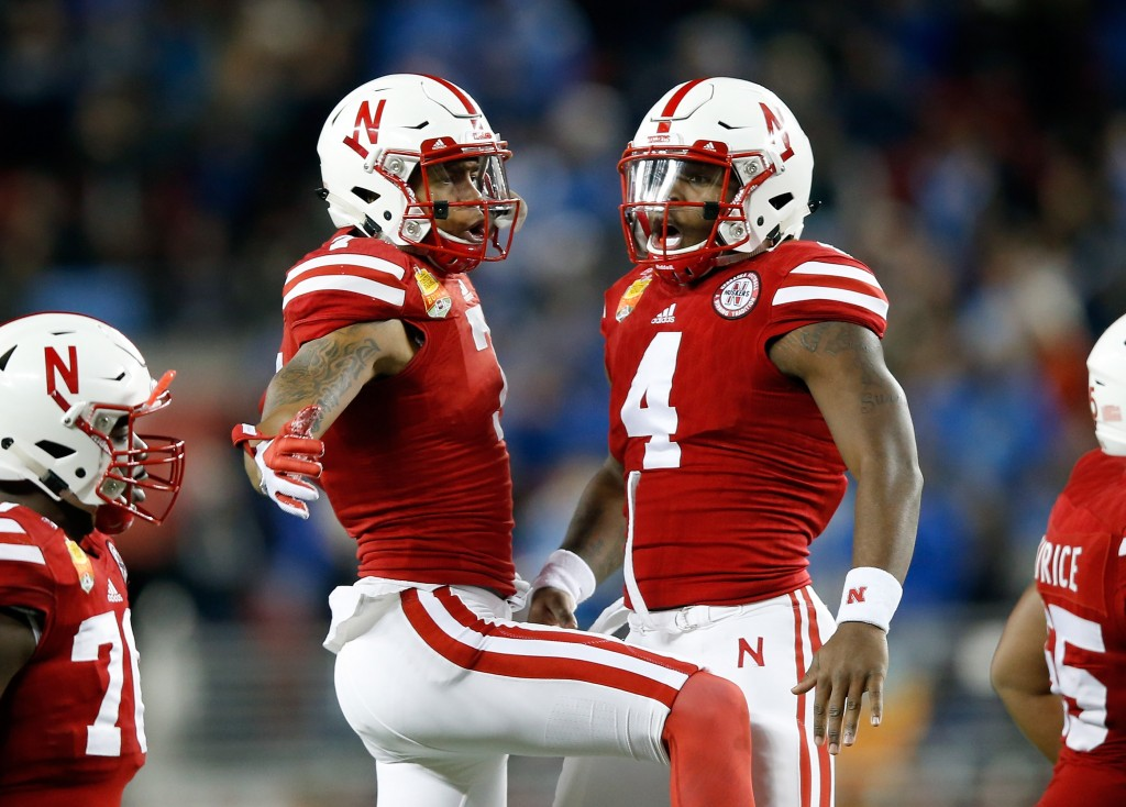 SANTA CLARA, CA - DECEMBER 26:  Taariq Allen #7 and Tommy Armstrong Jr. #4 of the Nebraska Cornhuskers celebrate after the Cornhuskers scored a touchdown against the UCLA Bruins during the Foster Farms Bowl at Levi's Stadium on December 26, 2015 in Santa Clara, California.  (Photo by Ezra Shaw/Getty Images)
