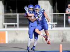 BOISE, ID - APRIL 9: Wide receiver Sean Modster #8 and wide receiver Cedrick Wilson #80 of the Boise State Broncos celebrate a touchdown during first half action at the Boise State Broncos spring game on April 9, 2016 at Albertsons Stadium in Boise, Idaho. (Photo by Loren Orr/Getty Images)