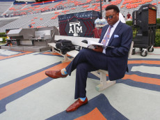 AUBURN, AL - SEPTEMBER 17:  Texas A&M Aggies head coach Kevin Sumlin sits on a bench looking at the game program before an NCAA college football game the Auburn Tigers on September 17, 2016 in Auburn, Alabama. (Photo by Butch Dill/Getty Images)