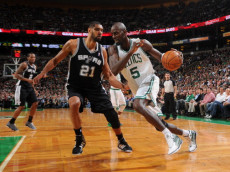 BOSTON, MA - APRIL 4:  Kevin Garnett #5 of the Boston Celtics drives the ball against Tim Duncan #21 of the San Antonio Spurs on April 4, 2012 at the TD Garden in Boston, Massachusetts. (Photo by Brian Babineau/NBAE via Getty Images)