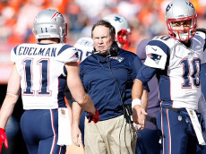 DENVER, CO - JANUARY 24: Head coach Bill Belichick of the New England Patriots speaks to Julian Edelman #11 in the first half against the Denver Broncos in the AFC Championship game at Sports Authority Field at Mile High on January 24, 2016 in Denver, Colorado. (Photo by Christian Petersen/Getty Images)