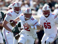 EAST LANSING, MI - SEPTEMBER 24:  Alex Hornibrook #12 of the Wisconsin Badgers runs with the ball during the game against the Michigan State Spartans at Spartan Stadium on September 24, 2016 in East Lansing, Michigan.  (Photo by Bobby Ellis/Getty Images)